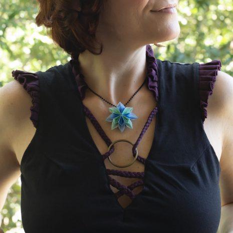 Mint-blue-kirigami-pinwheel-pendant-model-closeup